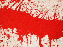 Splashes of a red paint Stock Photos