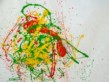 Splashes of red and yellow green paint on a white background. Expressionism royalty free stock photos