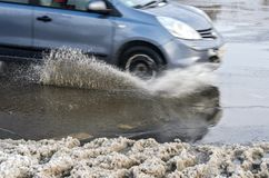Splashes from under the wheels of the car royalty free stock photos