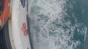 Splashes of water behind the yacht. stock footage