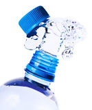 Splashes of water from a bottle Stock Image