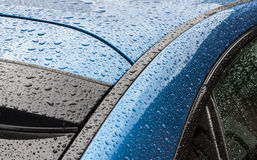 Splashes and water drops on а body of the car Stock Image