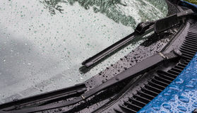 Splashes and water drops on acar windows. Splashes and water drops on a blue body and car windows Stock Photography