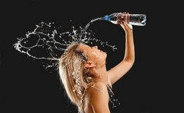 Splashes of water on the face of woman royalty free stock photos