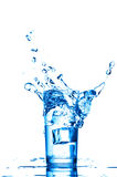 Splashes of water and ice cubes Stock Photo