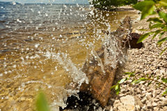 Splashes of water from the waves Stock Photos