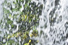 Splashes of the waterfall. Splashes of a waterfall that vigorously scatters Stock Image