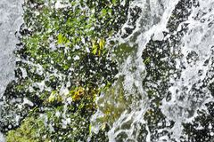 Splashes of the waterfall. Splashes of a waterfall that vigorously scatters Royalty Free Stock Image