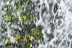 Splashes of the waterfall. Splashes of a waterfall that vigorously scatters Royalty Free Stock Images