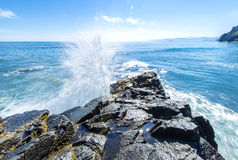 Splashes of waves of ocean and rock on Pacific ocean on Kamchatk Royalty Free Stock Image