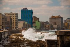 Splashes of waves .View from the Malecon promenade to the city. Cuba. Havana. Splashes of waves. View from the Malecon promenade to the city. Cuba. Havana Stock Photography