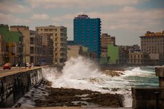Splashes of waves .View from the Malecon promenade to the city. Cuba. Havana. Splashes of waves. View from the Malecon promenade to the city. Cuba. Havana Stock Photos