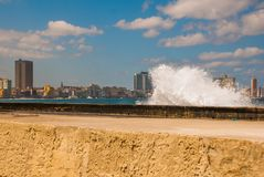Splashes of waves .View from the Malecon promenade to the city. Cuba. Havana. Splashes of waves. View from the Malecon promenade to the city. Cuba. Havana Royalty Free Stock Photography