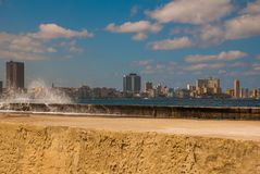 Splashes of waves .View from the Malecon promenade to the city. Cuba. Havana. Splashes of waves. View from the Malecon promenade to the city. Cuba. Havana Royalty Free Stock Photos