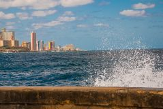 Splashes of waves .View from the Malecon promenade to the city. Cuba. Havana. Splashes of waves. View from the Malecon promenade to the city. Cuba. Havana Royalty Free Stock Image