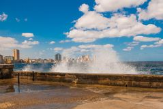 Splashes of waves .View from the Malecon promenade to the city. Cuba. Havana. Splashes of waves. View from the Malecon promenade to the city. Cuba. Havana Stock Image