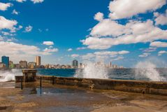 Splashes of waves .View from the Malecon promenade to the city. Cuba. Havana. Splashes of waves. View from the Malecon promenade to the city. Cuba. Havana Royalty Free Stock Photo