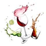 Splashing alcohols Royalty Free Stock Image