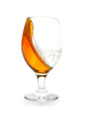 Splashing amber colored beer into glass Royalty Free Stock Photography