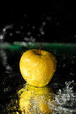 Splashing on apple Royalty Free Stock Photography