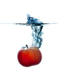 Splashing apple. HQ studio shot. Camera: Canon EOS 5D Mark II Stock Image