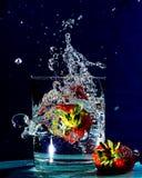 Splashing A Berry Stock Image