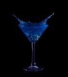 Splashing on blue martini on black Stock Images