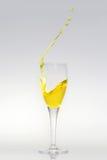 Splashing champagne. Champagne flute with splashing liquid stock image