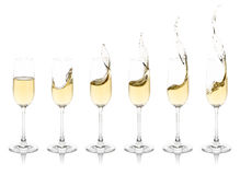 Splashing Champagne Flutes Royalty Free Stock Photos