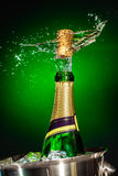 Splashing champagne. On a green background royalty free stock images