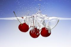 Splashing cherries Stock Photo