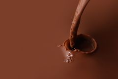 Splashing chocolate stock images