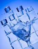 Splashing cocktail. Blue beverage and ice Royalty Free Stock Photography