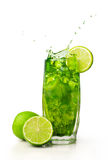 Splashing cocktail with mint and lime Stock Photography