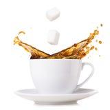 Splashing coffee Stock Photos