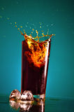 Splashing Cola Royalty Free Stock Photography