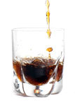 Splashing cola Royalty Free Stock Photo