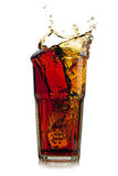 Splashing cola in glass.  on white background Royalty Free Stock Image