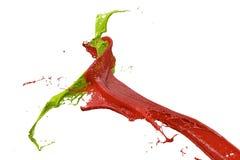 Splashing color in red and green. Splashing wall color in red and green Stock Photography