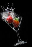 Splashing drink Stock Images