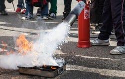Splashing Foam from Fire Extinguisher. White foam splashing from fire extinguisher, detail of stream royalty free stock photography