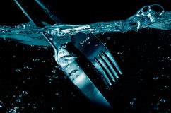 Splashing  Fork and  Knife in water Royalty Free Stock Photos