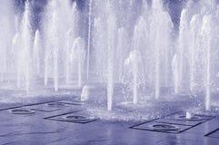 Splashing fountain. Jets in blue monochrome Stock Photo