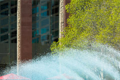 Splashing fountain. In city park Stock Photography