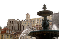 Splashing fountain at Rossio Square, Lisbon. Bronze french fountain at the Rossio or Pedro IV Square (Praca de D. Pedro IV) in the city of Lisbon, in Portugal Royalty Free Stock Images