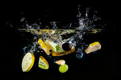 Splashing fruit on water. Royalty Free Stock Photography