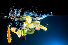Splashing fruit on water. Royalty Free Stock Images