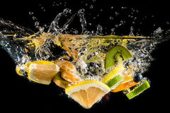 Splashing fruit on water. Royalty Free Stock Photo