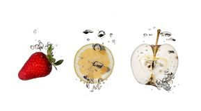 Splashing fruits. Isolated on white royalty free stock image