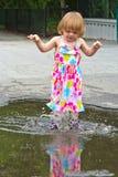Splashing Girl Puddle Jumper stock photography